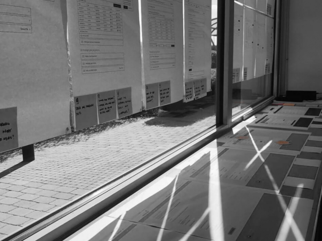 A wall of windows covered in public design critique